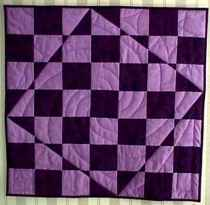 And another quilt! This one's by Anabeth Dollins, a retired mathematics teacher. Do you see Pythagoras?