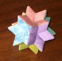 Another by Anabeth Dollins!  It's a rhombic hexecontahedron--more info here!