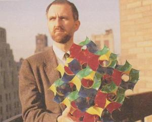 Alan Schoen with a model of a gyroid